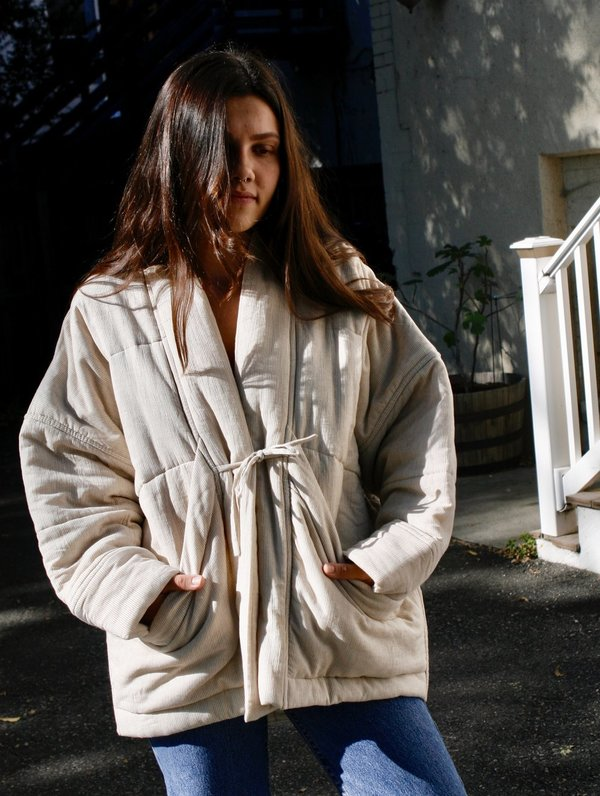 7115 by Szeki Pinstripes Quilted Sumo Coat in Beige