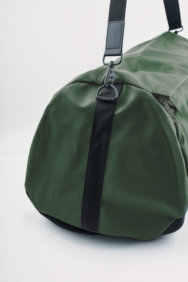 36b0fa2cce8 Rains Travel Duffel - Green   Garmentory