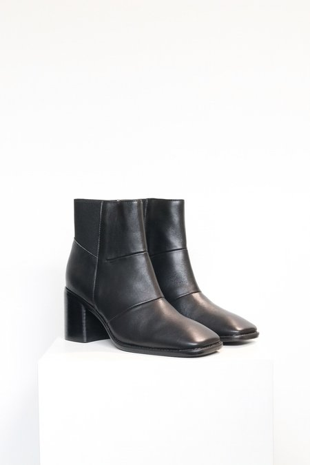 """INTENTIONALLY __________."" Hinge Boots - Black"