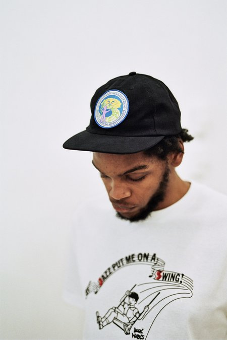 Book Works Makes The World Go 'Round Patch Hat - black