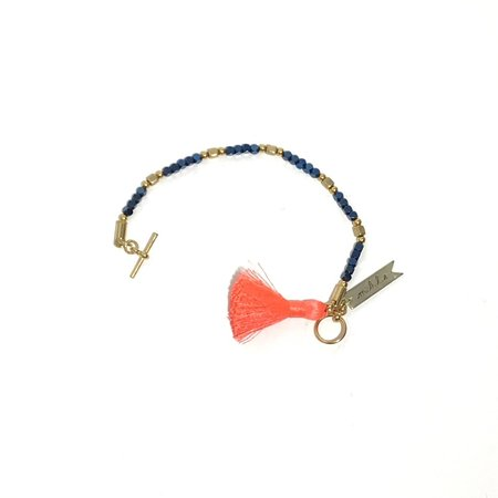 Marijke Bouchier Metallic beads with Orange Tassel Bracelet