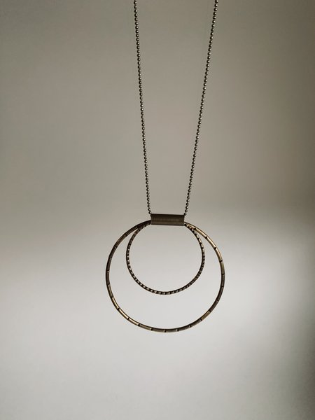 Rivet & Rise Stamped Motion Pendant Necklace