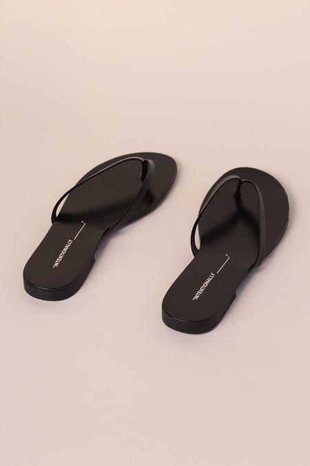 """INTENTIONALLY __________."" CYRUS Sandal - Black"