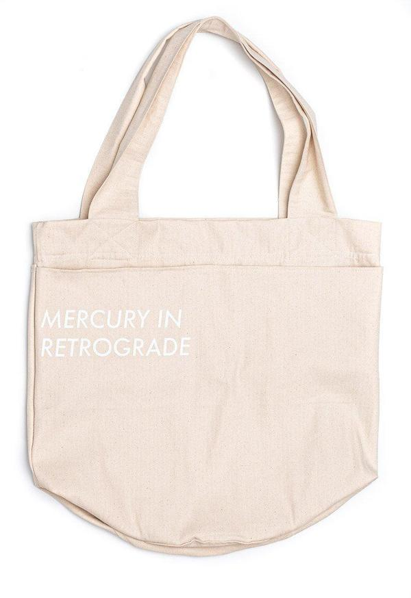 """Toit Volant """"MERCURY IN RETROGRADE"""" ROUND BASE TOTE BAG WITH POCKETS - Natural"""