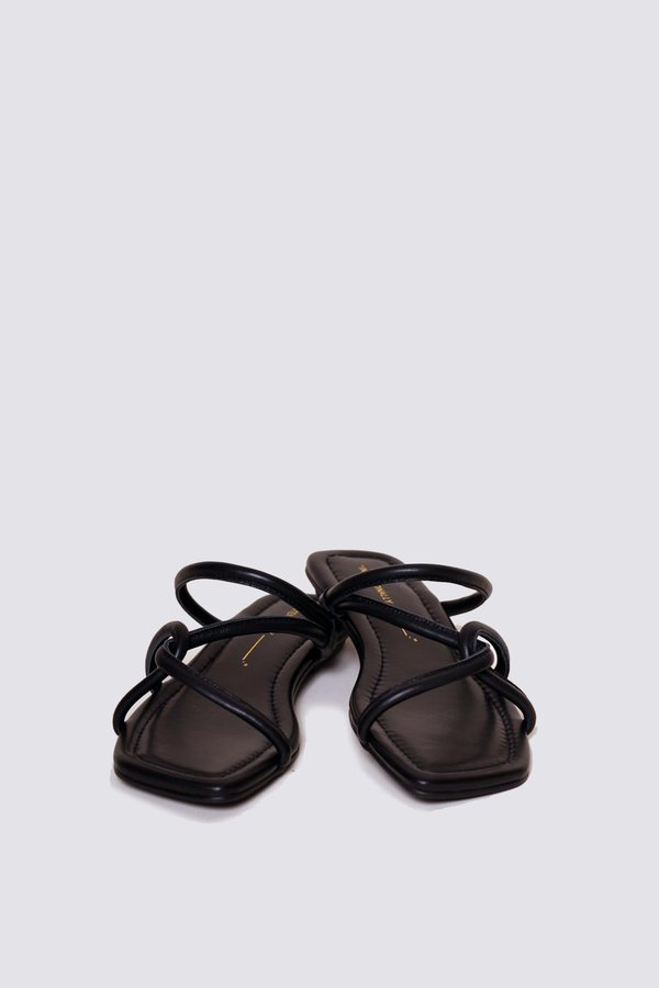 """INTENTIONALLY __________."" Kinney Sandal"