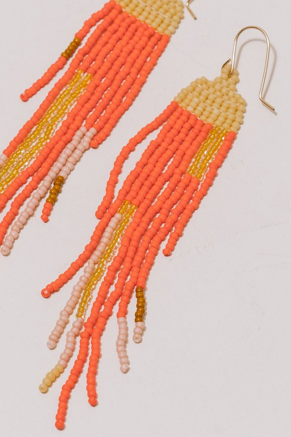 Lu in the Frey Fringes Earrings - Cream/Orange