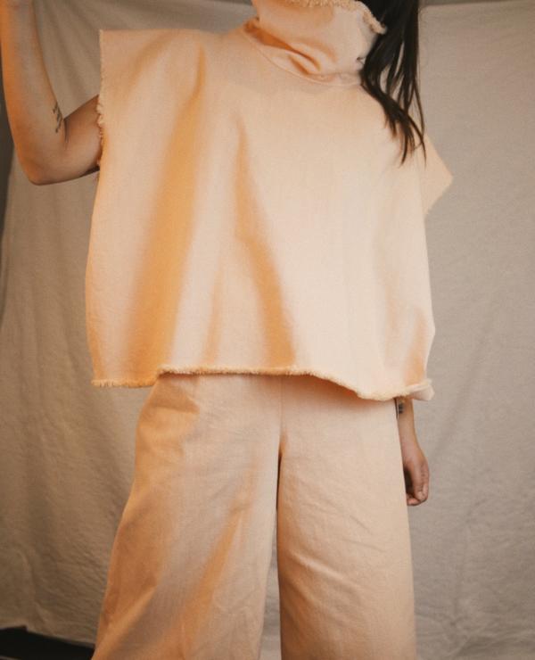 ASHLEY ROWE Sleeveless Turtleneck - Peach Nougat