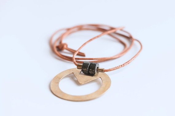 Knuckle Kiss Ohm Necklace