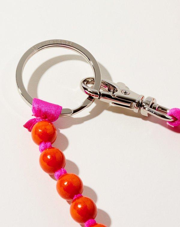 Perlen Long Keyholder in Orange on Pink