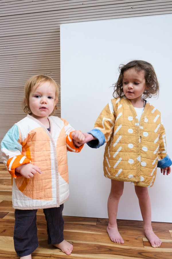 Kids CanDid Art Shapes & Angles Reversible Quilted Coat - Orange