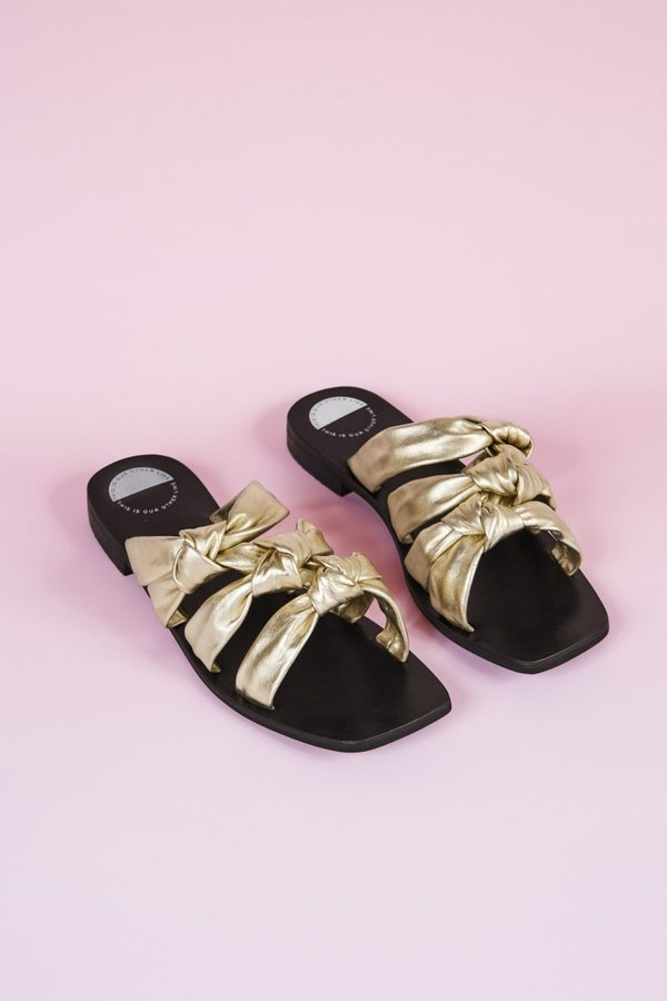 """""""INTENTIONALLY __________."""" Please Advise Sandals - Gold"""