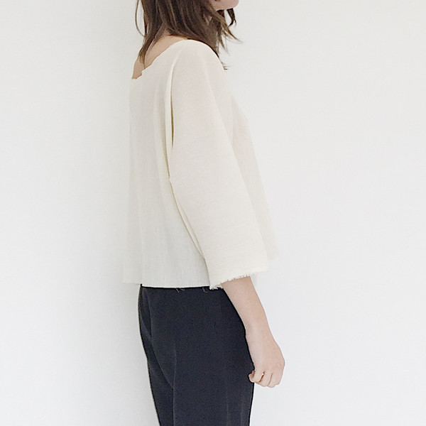 A Person Made Ivory Pleats Top